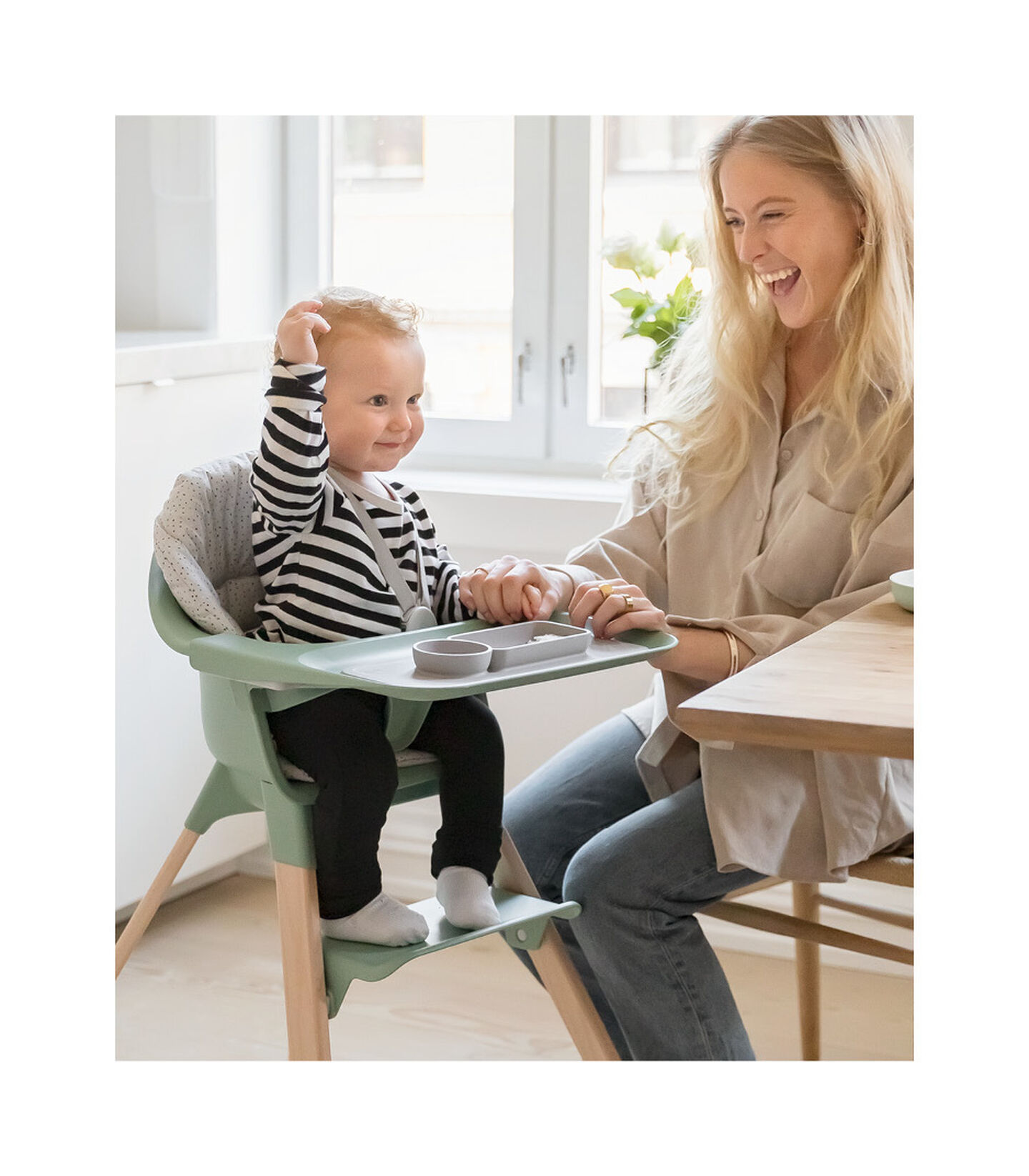 Stokke® Clikk™ High Chair. Natural Beech wood and Clover Green plastic parts.