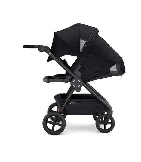 Stokke® Beat™ with Seat. Black. Parent facing. Extended Canopy. Sleep position.