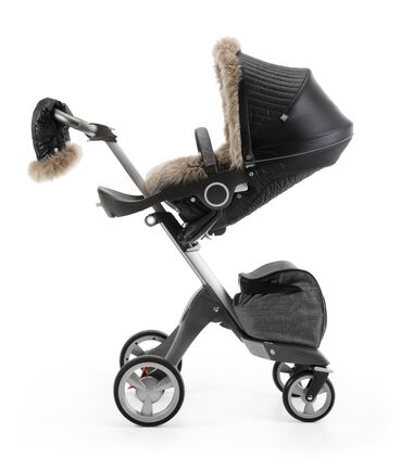 Stokke® Xplory® Black Melange and Stokke® Stroller Seat with Winter Kit Onyx Black.