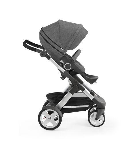 Stokke® Trailz with Stokke® Stroller Seat, forward facing, rest position. Black Melange.