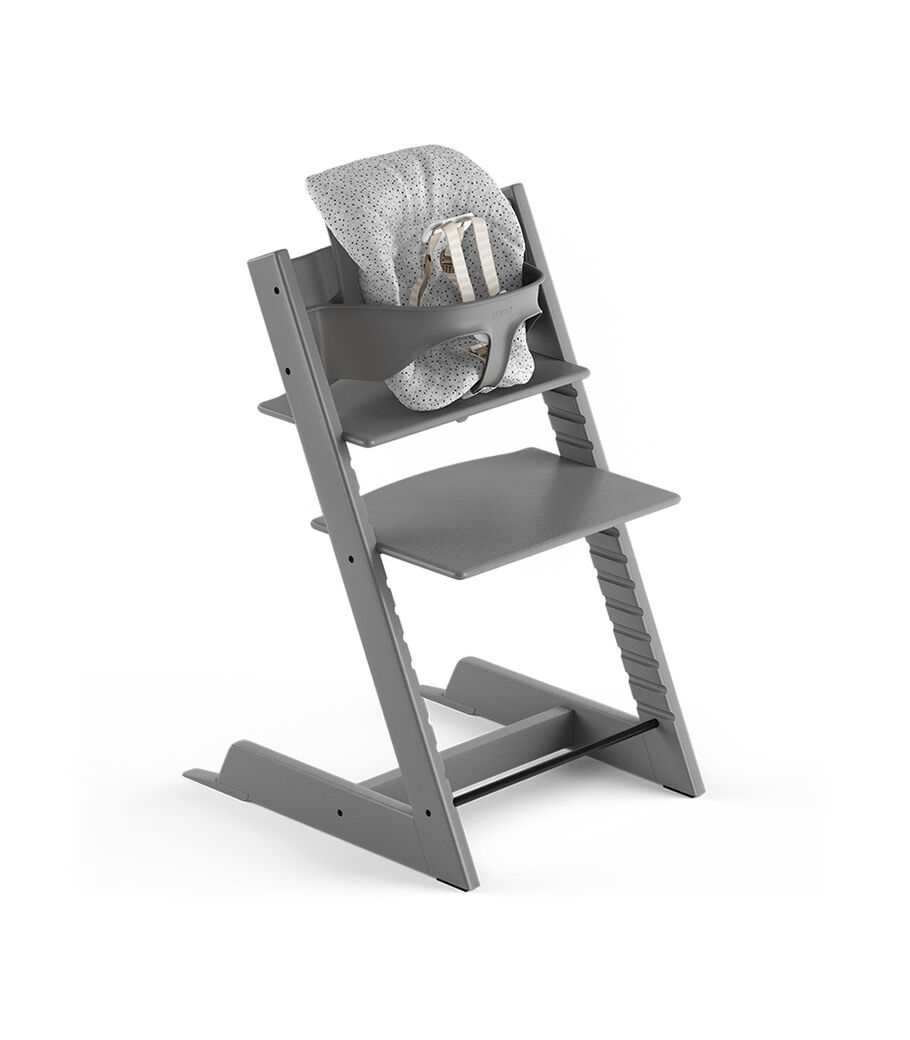 Tripp Trapp® Storm Grey, Beech. With Tripp Trapp® Baby Set and Baby Cushion Cloud Sprinkle. US version with Harness.