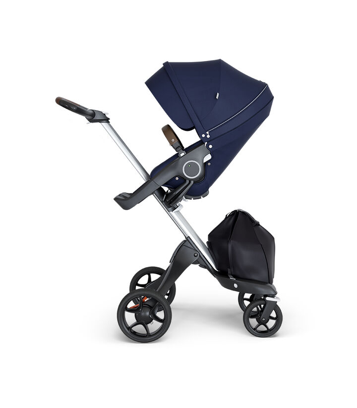 Stokke® Xplory® wtih Silver Chassis and Leatherette Brown handle. Stokke® Stroller Seat Deep Blue.