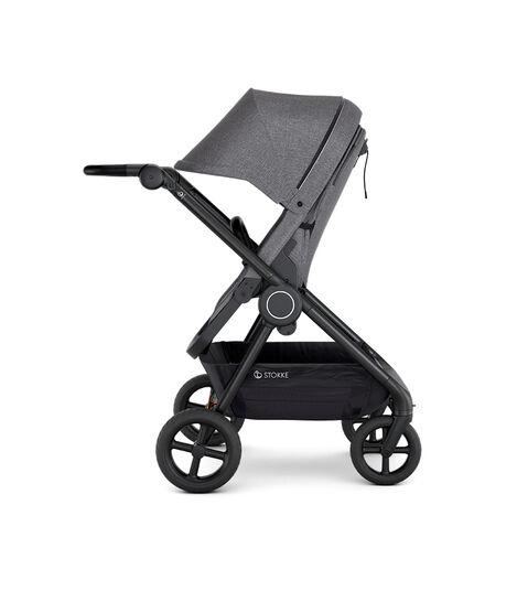 Stokke® Beat™ with Seat. Black Melange. Parent facing.