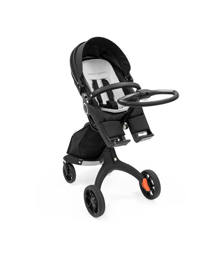 Stokke® Xplory® with Stokke® Stroller Seat and tokke® Stroller All Weather Inlay, cooling polyester.