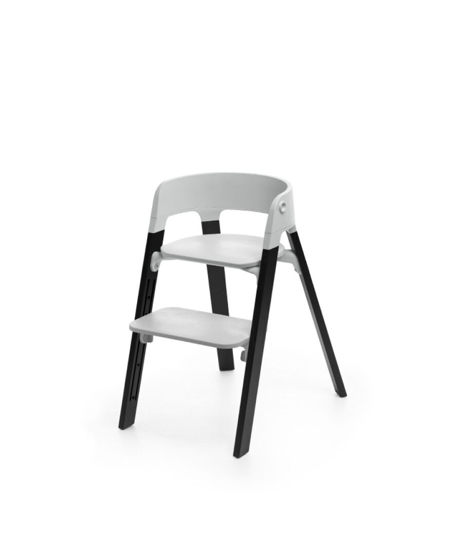 Stokke® Steps™ Oak Black with Light Grey seat.