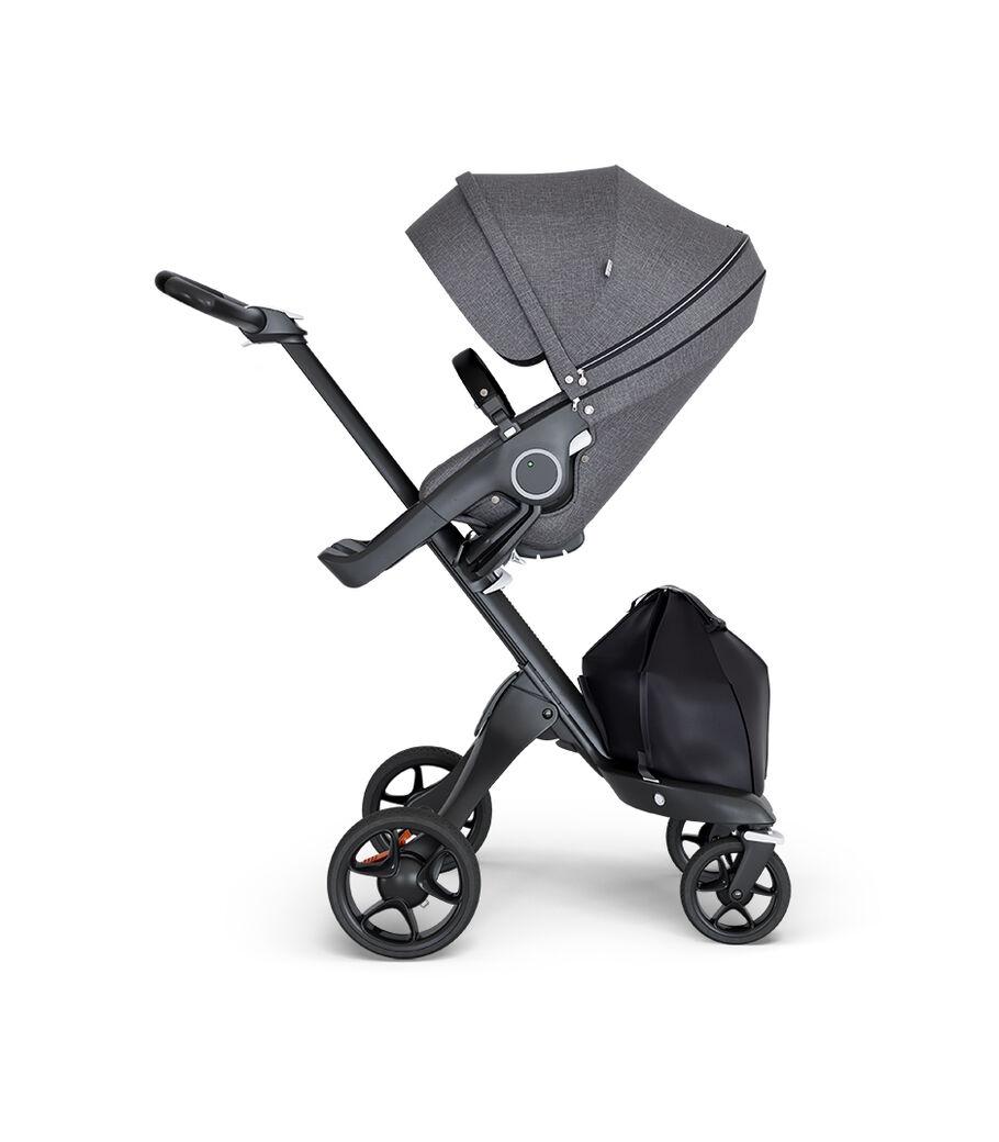 Stokke® Xplory® wtih Black Chassis and Leatherette Black handle. Stokke® Stroller Seat Black Melange. view 3