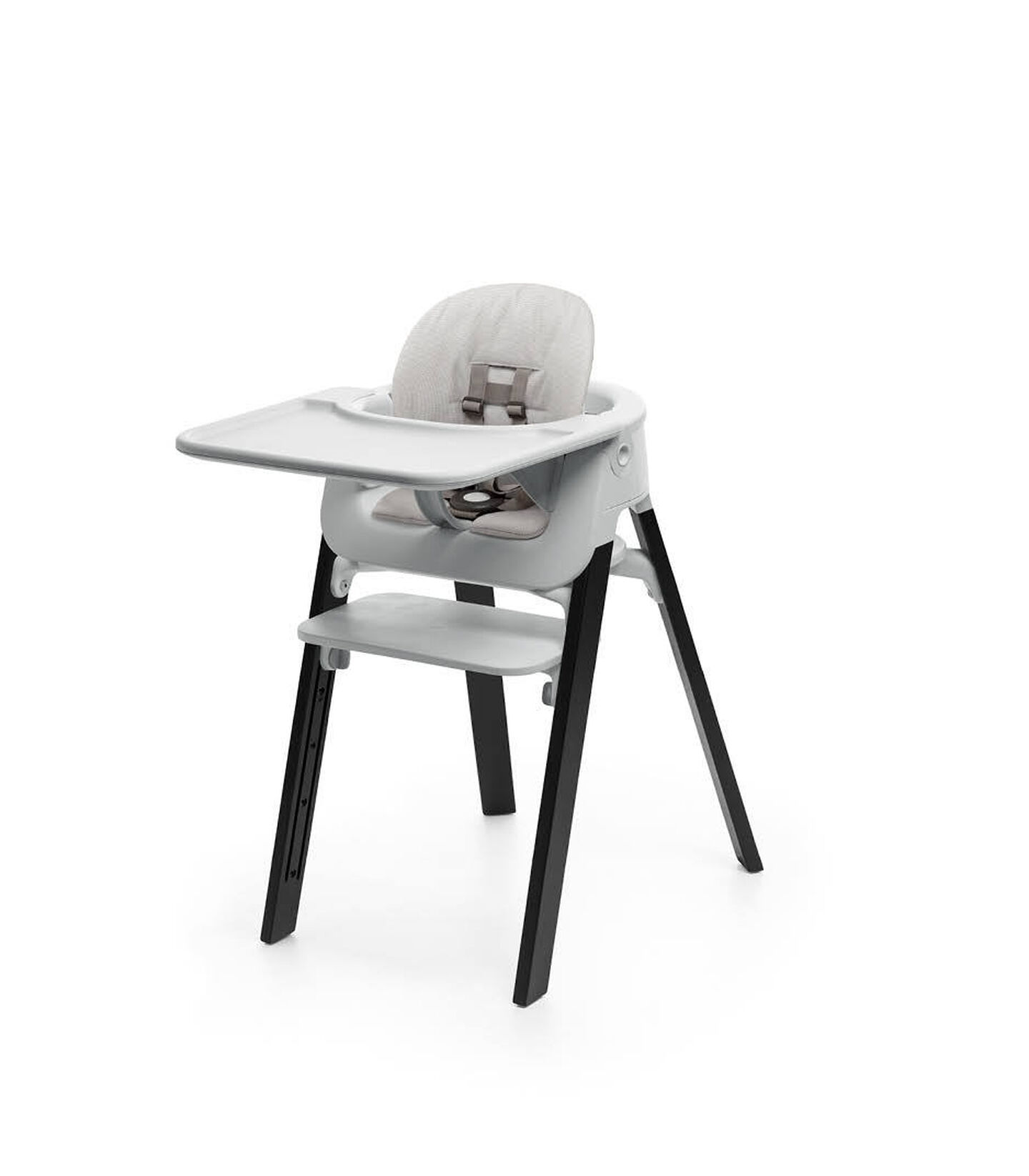 Stokke® Steps™ Oak Black with Accessories. Baby Set Light Grey. Baby Set Cushion Timeless Grey. Baby Set Tray Light Grey.