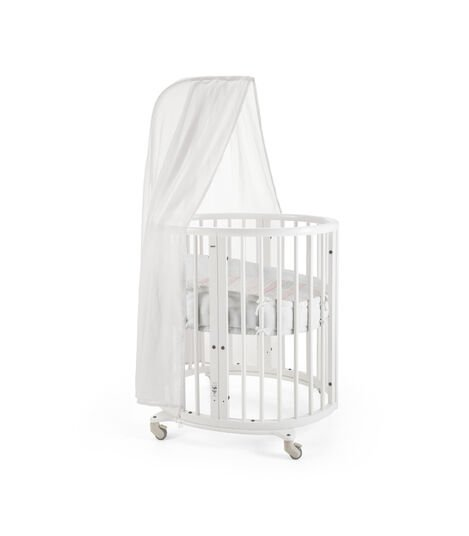Stokke® Sleepi Mini, Natural. Canopy, Bumper and Fitted Sheet, Coral Straw. view 3