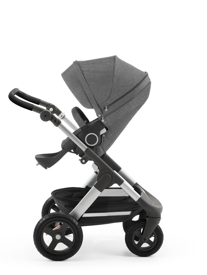 Stokke® Trailz™ with silver chassis and Stokke® Stroller Seat, Black Melange. Leatherette Handle. Terrain Wheels.