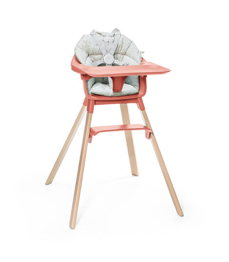 Stokke® Clikk™ High Chair. Natural Beech wood and Sunny Coral plastic parts including Tray. Cushion Grey Sprinkle and Harness. view 5