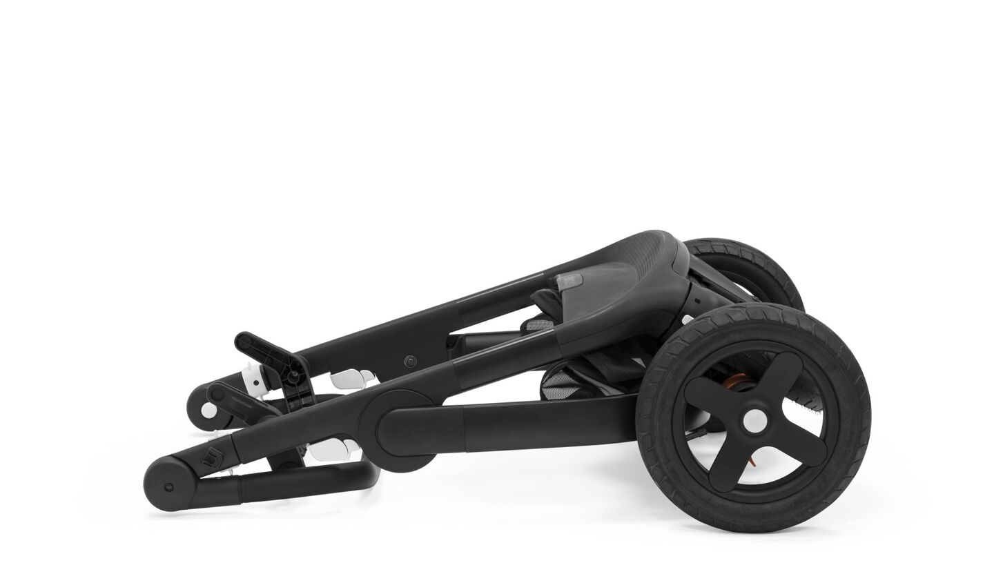 Stokke® Trailz™ Chassis Black with Black Leatherette Handle. Stokke® Stroller Seat, Black Melange.