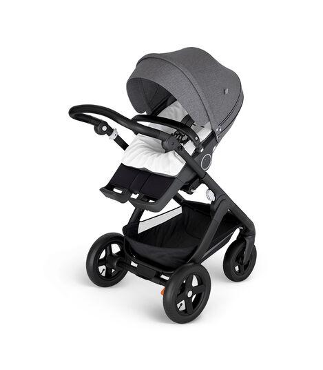 Stokke® Trailz™ with Black Chassis and Stokke® Stroller Seat Black Melange. Stokke® Stroller Terry Cloth Cover.