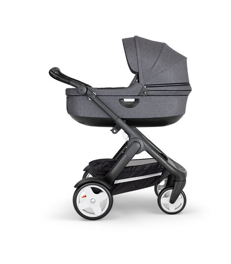 Stokke® Trailz™ with Black Chassis, Black Leatherette and Classic Wheels. Stokke® Stroller Carry Cot, Black Melange.