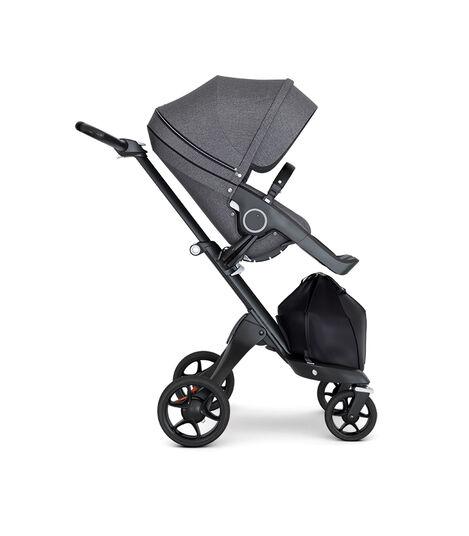 Stokke® Xplory® wtih Black Chassis and Leatherette Black handle. Stokke® Stroller Seat Seat Black Melange. Forward facing.