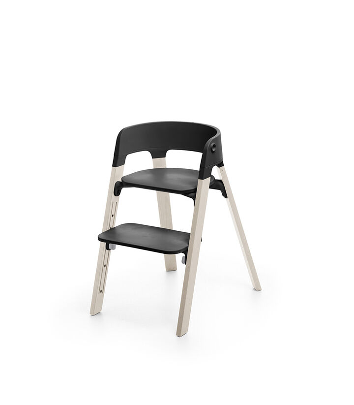 Stokke® Steps™ Whitewash with Black seat and footrest in high position.