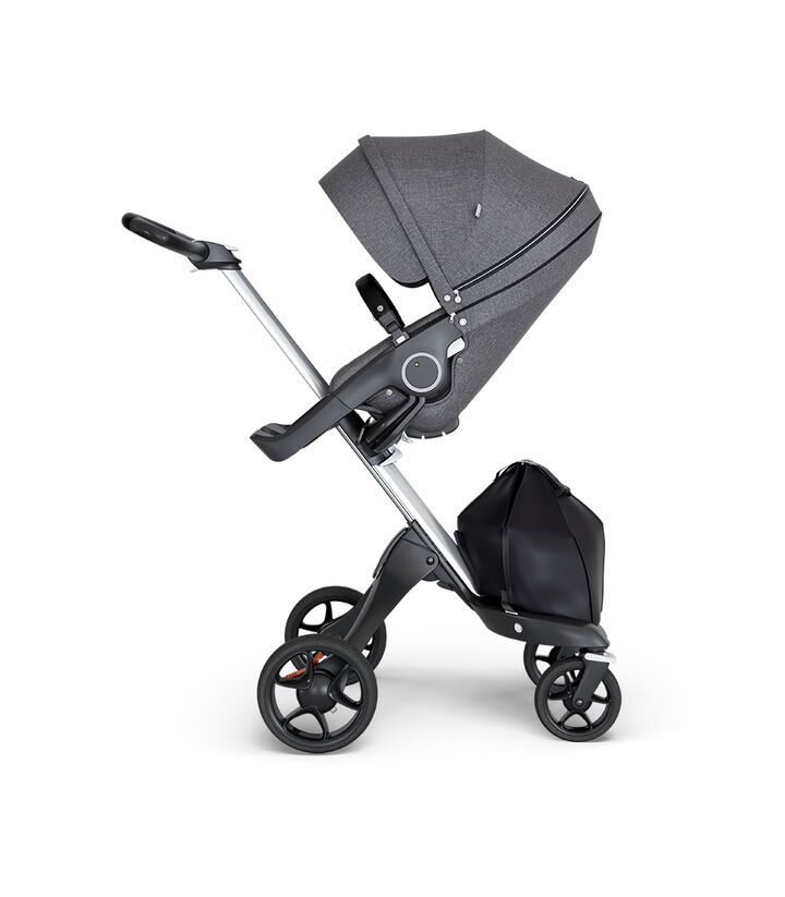 Stokke® Xplory® wtih Silver Chassis and Leatherette Black handle. Stokke® Stroller Seat Black Melange. view 1