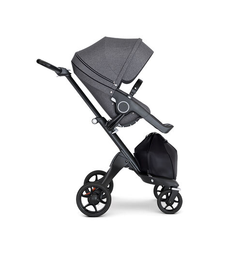 Stokke® Xplory® wtih Black Chassis and Leatherette Black handle. Stokke® Stroller Seat Seat Black Melange. Forward facing. view 3