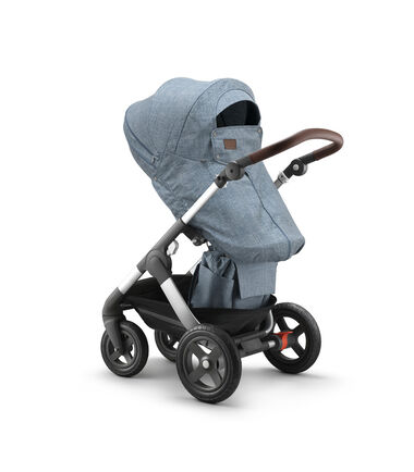 Stokke® Trailz™ with Stokke® Stroller Seat and Storm Cover, Nordic Blue.