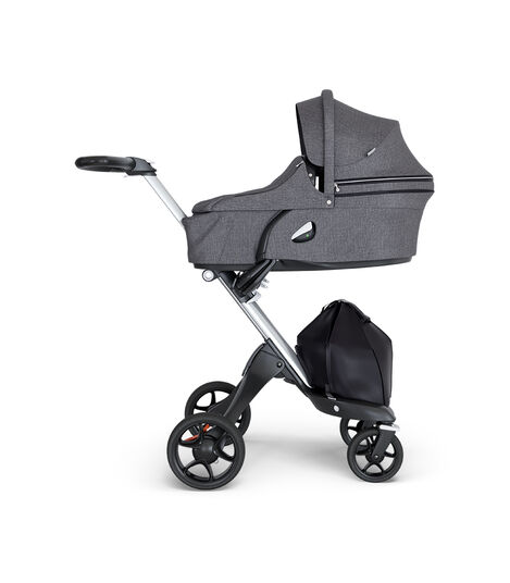 Stokke® Xplory® wtih Silver Chassis and Leatherette Black handle. Stokke® Stroller Carry Cot Black Melange. view 2