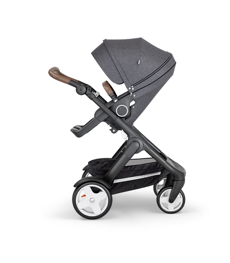 Stokke® Trailz™ with Black Chassis, Brown Leatherette and Classic Wheels. Stokke® Stroller Seat, Black Melange. view 2