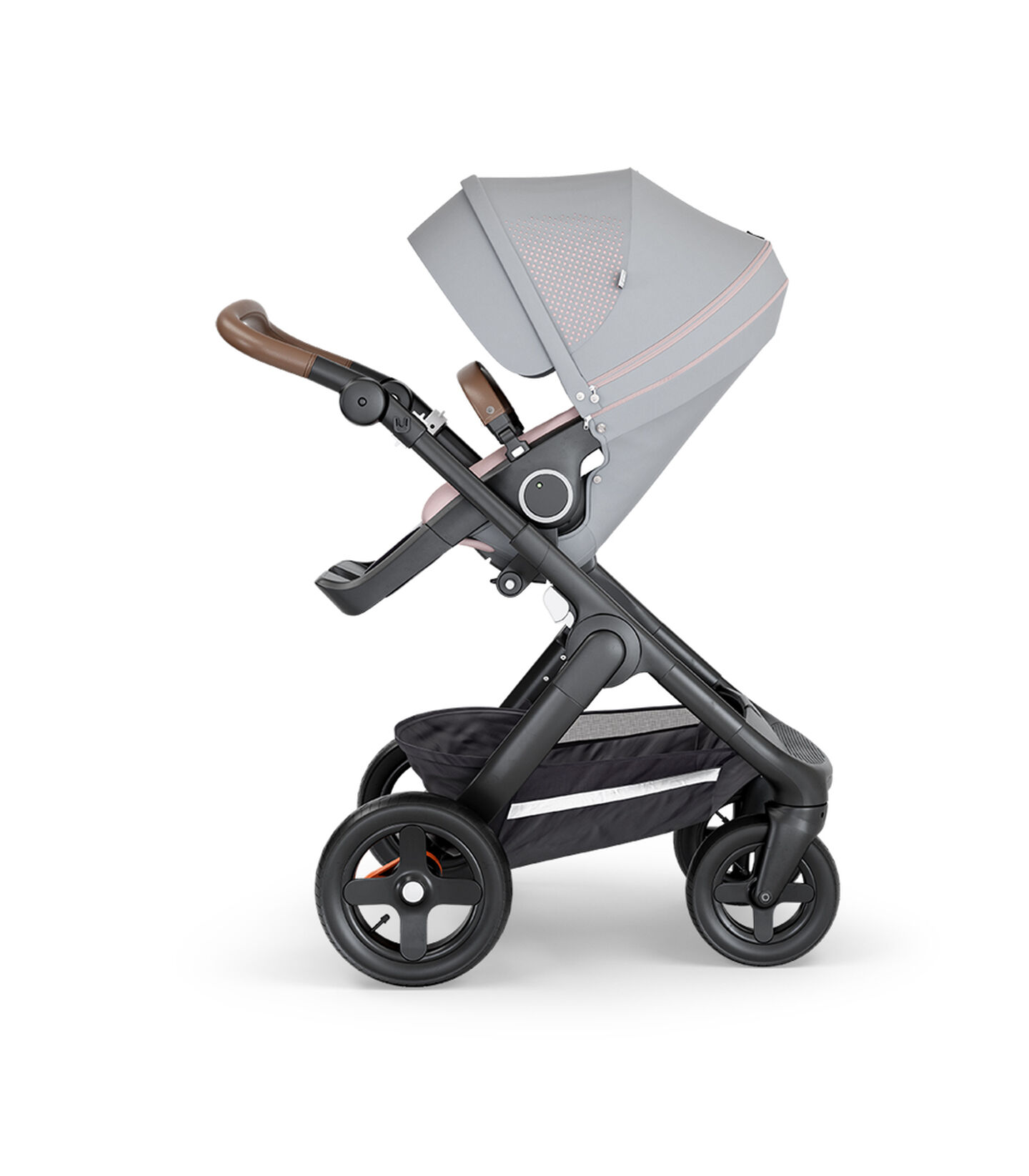 Stokke® Trailz™ with Black Chassis, Brown Leatherette and Terrain Wheels. Stokke® Stroller Seat, Athleisure Pink.