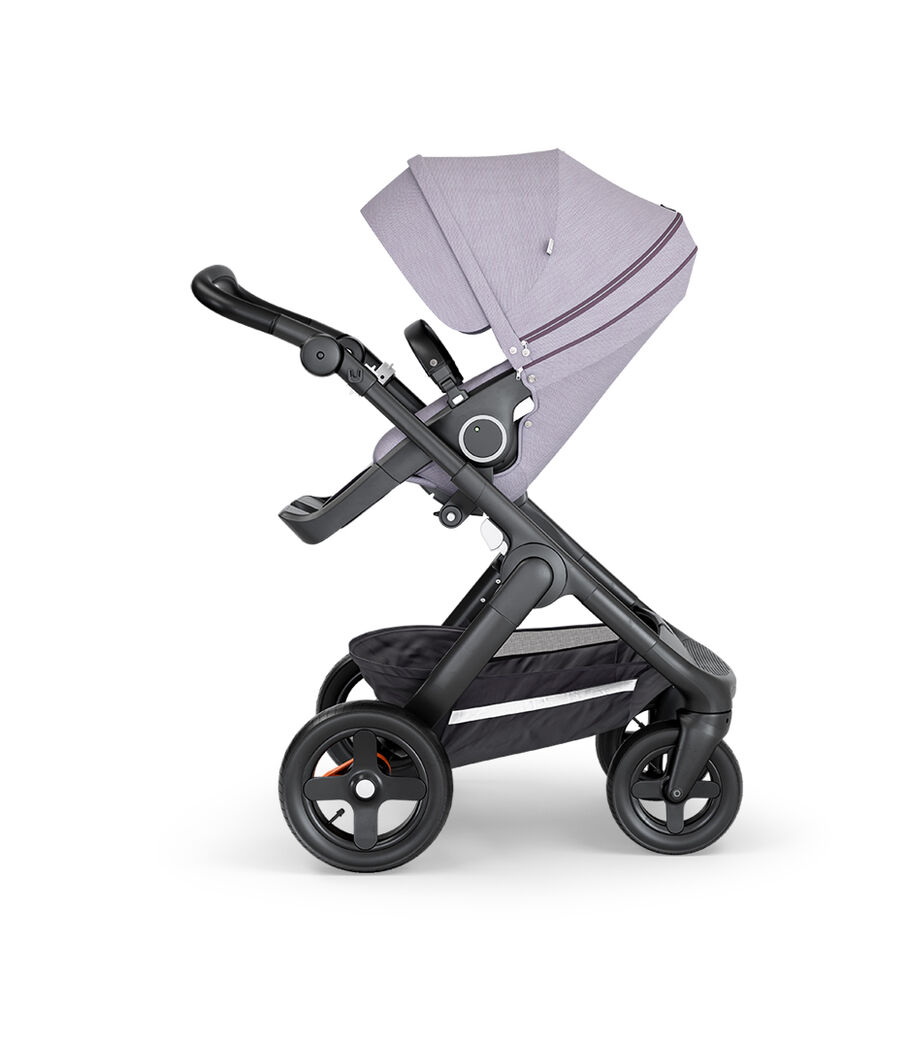 Stokke® Trailz™ with Black Chassis, Black Leatherette and Terrain Wheels. Stokke® Stroller Seat, Brushed Lilac.