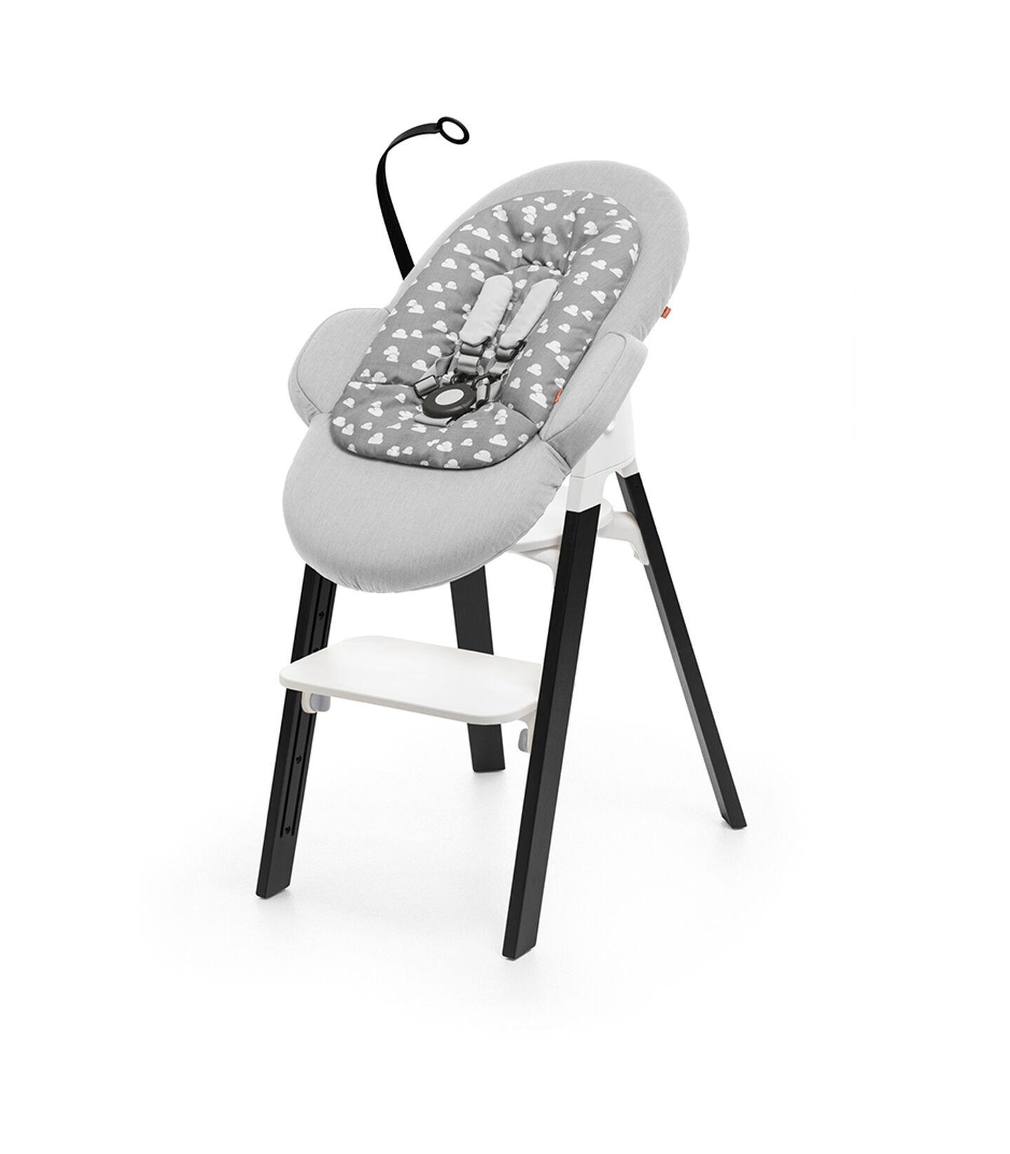 Stokke® Steps™ Chair Oak Black and Stokke® Steps™ Bouncer with Newborn Insert, Grey.