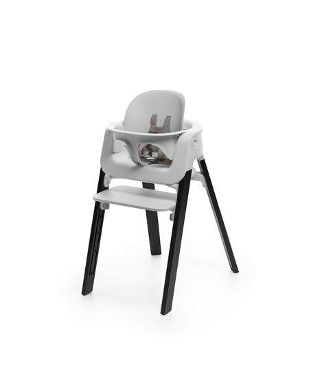 Stokke® Steps™ Oak Black chair with Baby Set Light Grey.