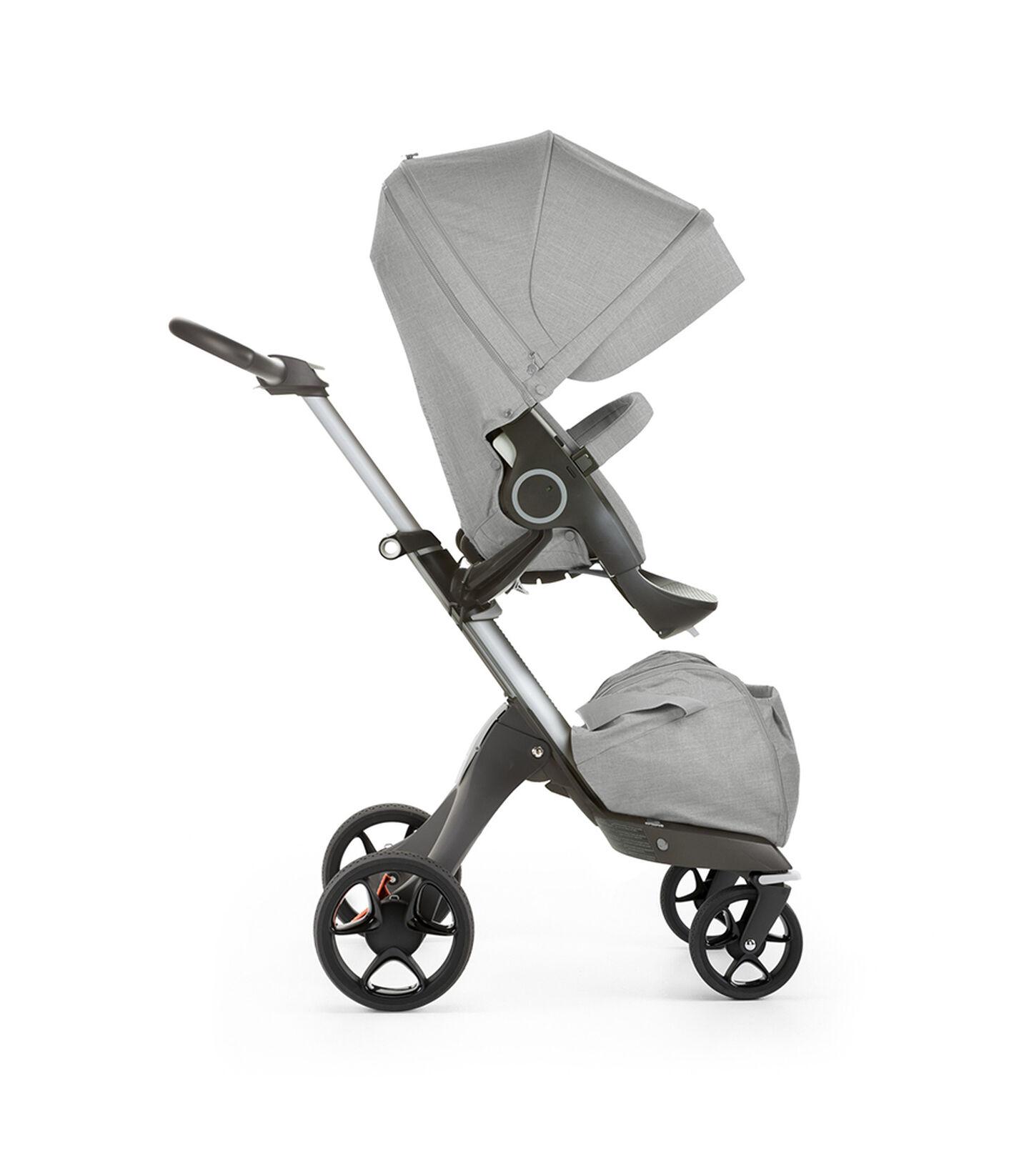 Stokke® Xplory® with Stokke® Stroller Seat, forward facing, active position. Grey Melange. New wheels 2016.