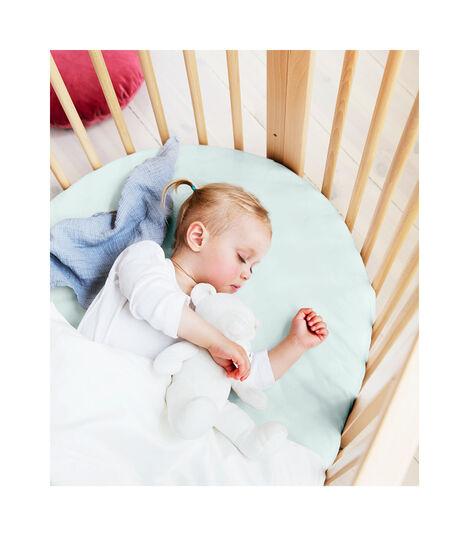 Stokke® Sleepi™ Bed, Natural with Fitted Sheet Powder Blue.