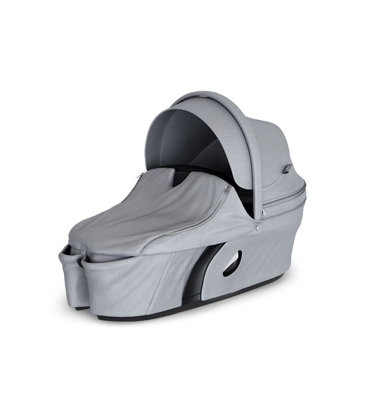 Stokke® Xplory® Carry Cot Grey Melange. With Storm Cover. view 1