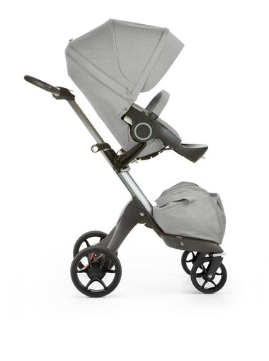 Stokke® Xplory® with Stokke® Stroller Seat, forward facing, rest position. Grey Melange. New wheels 2016.