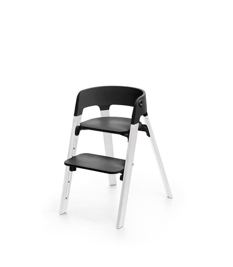 Stokke® Steps™ Oak White with Black seat and footrest in high position.