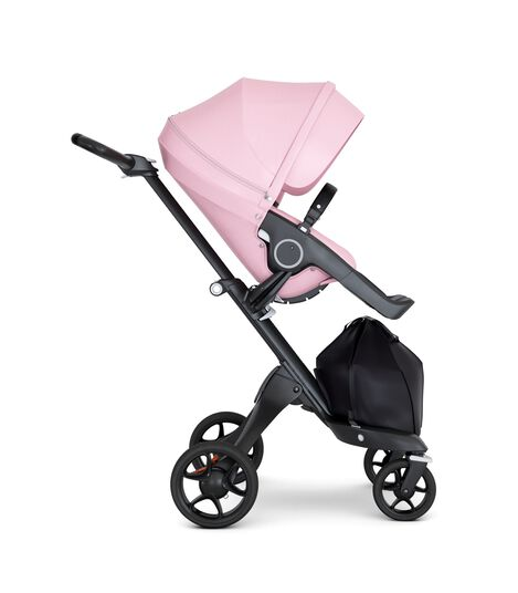 Stokke® Xplory® wtih Black Chassis and Leatherette Black handle. Stokke® Stroller Seat Seat Lotus Pink. Forward facing.