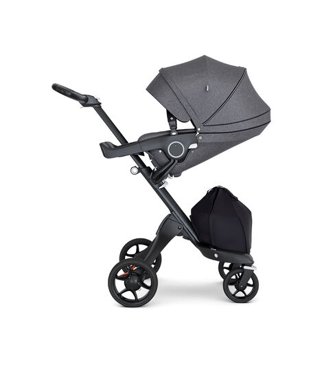 Stokke® Xplory® with Black Chassis and Leatherette Black handle. Stokke® Stroller Seat Black Melange with extended canopy. view 6