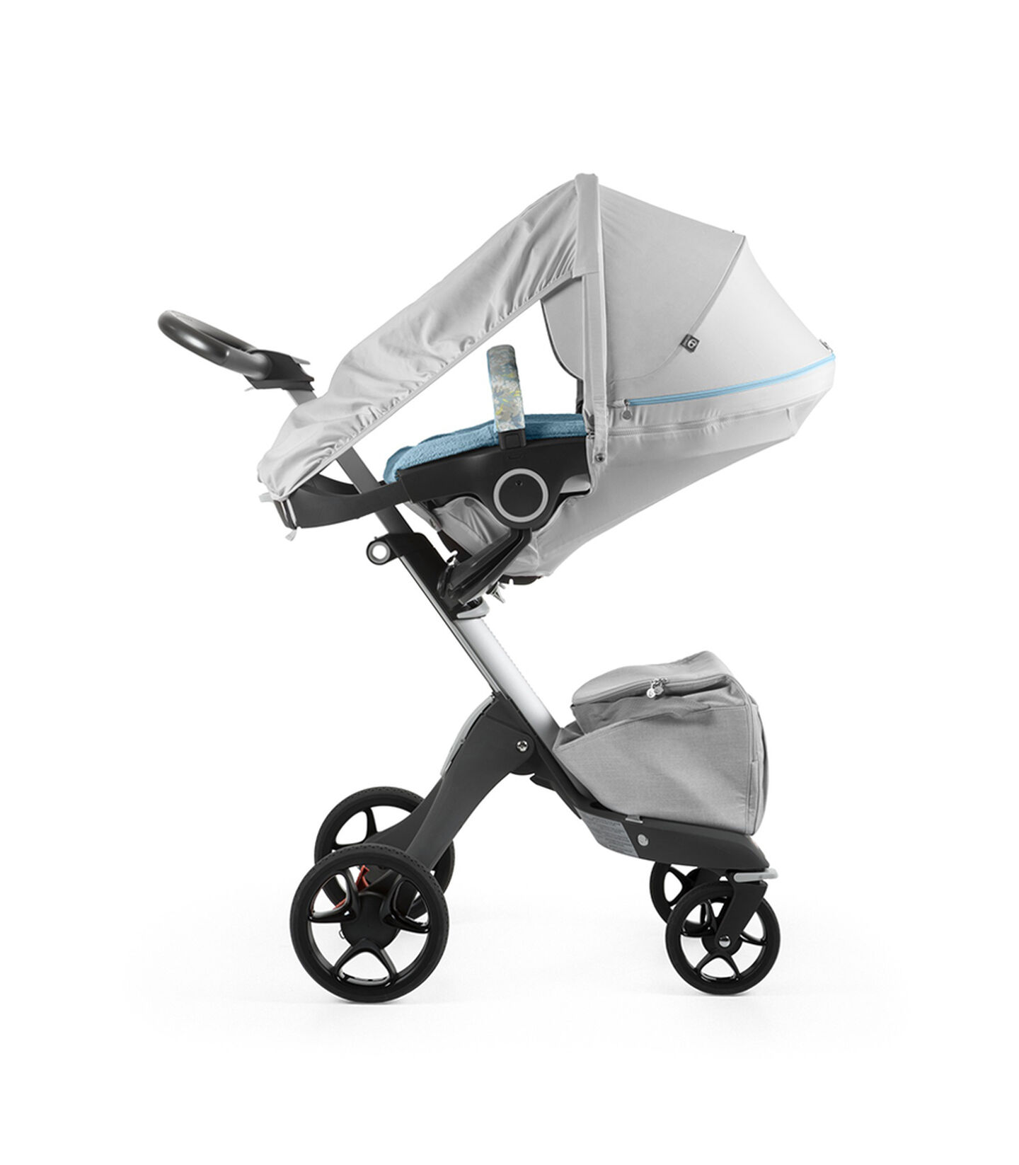 Stokke® Xplory® With Stokke® Stroller Seat and Flora Blue Summer Kit.