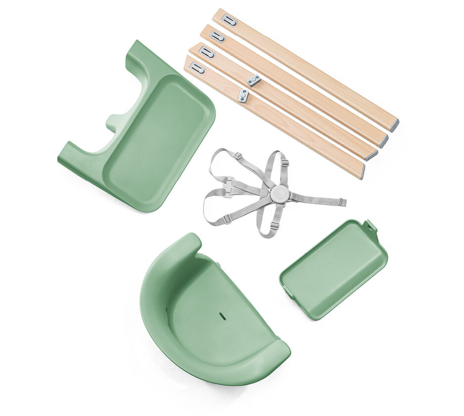 Stokke® Clikk™ High Chair. Natural Beech wood and Clover Green plastic parts. What's included overview.