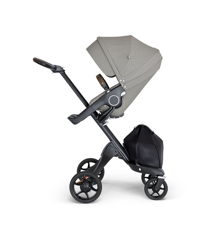 Stokke® Xplory® wtih Black Chassis and Leatherette Brown handle. Stokke® Stroller Seat Seat Brushed Grey.