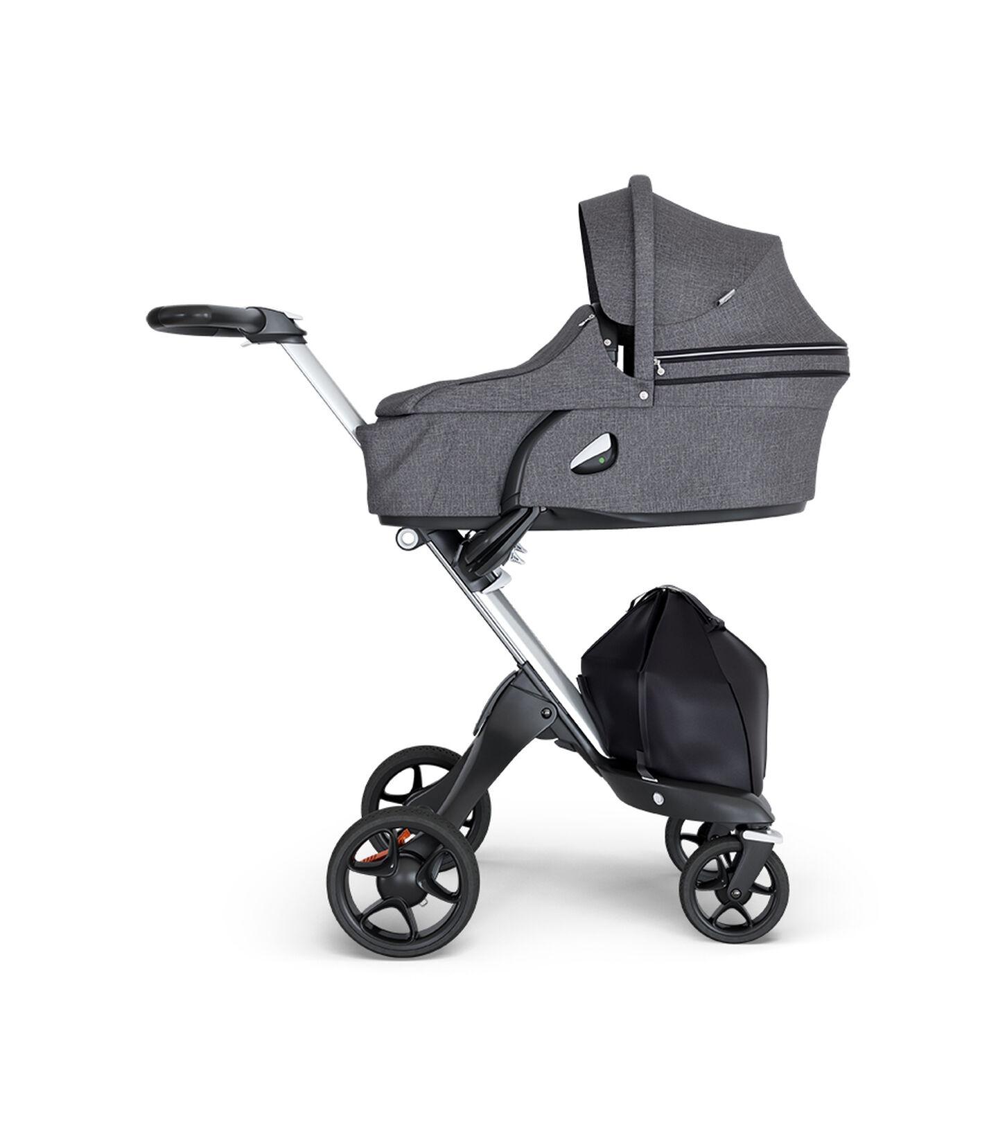 Stokke® Xplory® wtih Silver Chassis and Leatherette Black handle. Stokke® Stroller Carry Cot Black Melange.