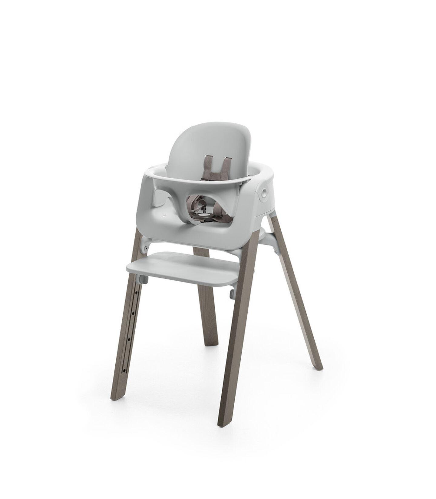 Stokke® Steps™ Hazy Grey chair with Baby Set Light Grey.