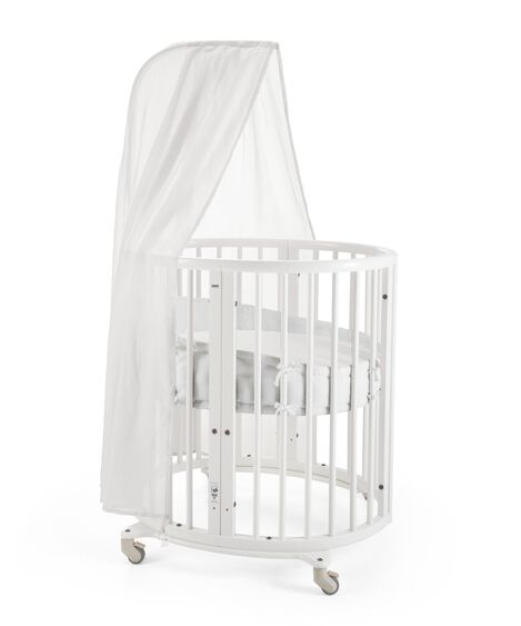 Stokke® Sleepi Mini, White. Canopy, Bumper and Fitted Sheet White.