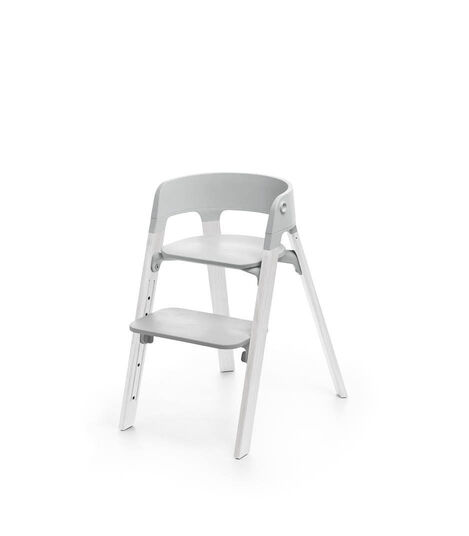 Stokke® Steps™ Oak White with Light Grey seat.