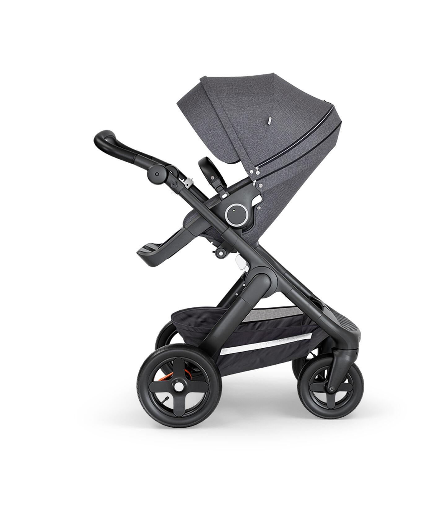 Stokke® Trailz™ with Black Chassis, Black Leatherette and Terrain Wheels. Stokke® Stroller Seat, Black Melange. view 2