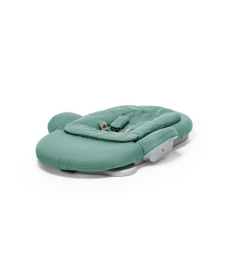 Stokke® Steps Bouncer in Cool Jade. Folded.