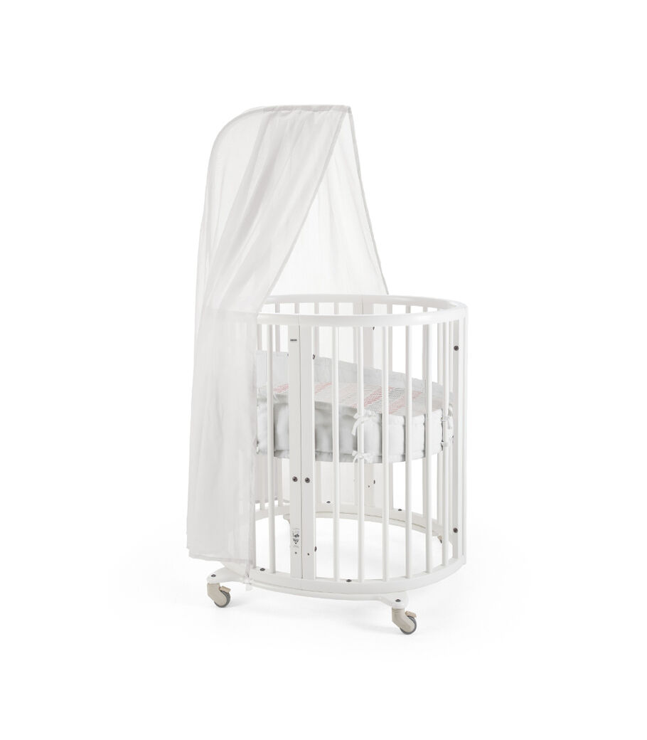 Stokke® Sleepi Mini, Natural. Canopy, Bumper and Fitted Sheet, Coral Straw. view 21