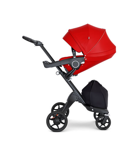 Stokke® Xplory® with Black Chassis and Leatherette Black handle. Stokke® Stroller Seat Red with extended canopy. view 5