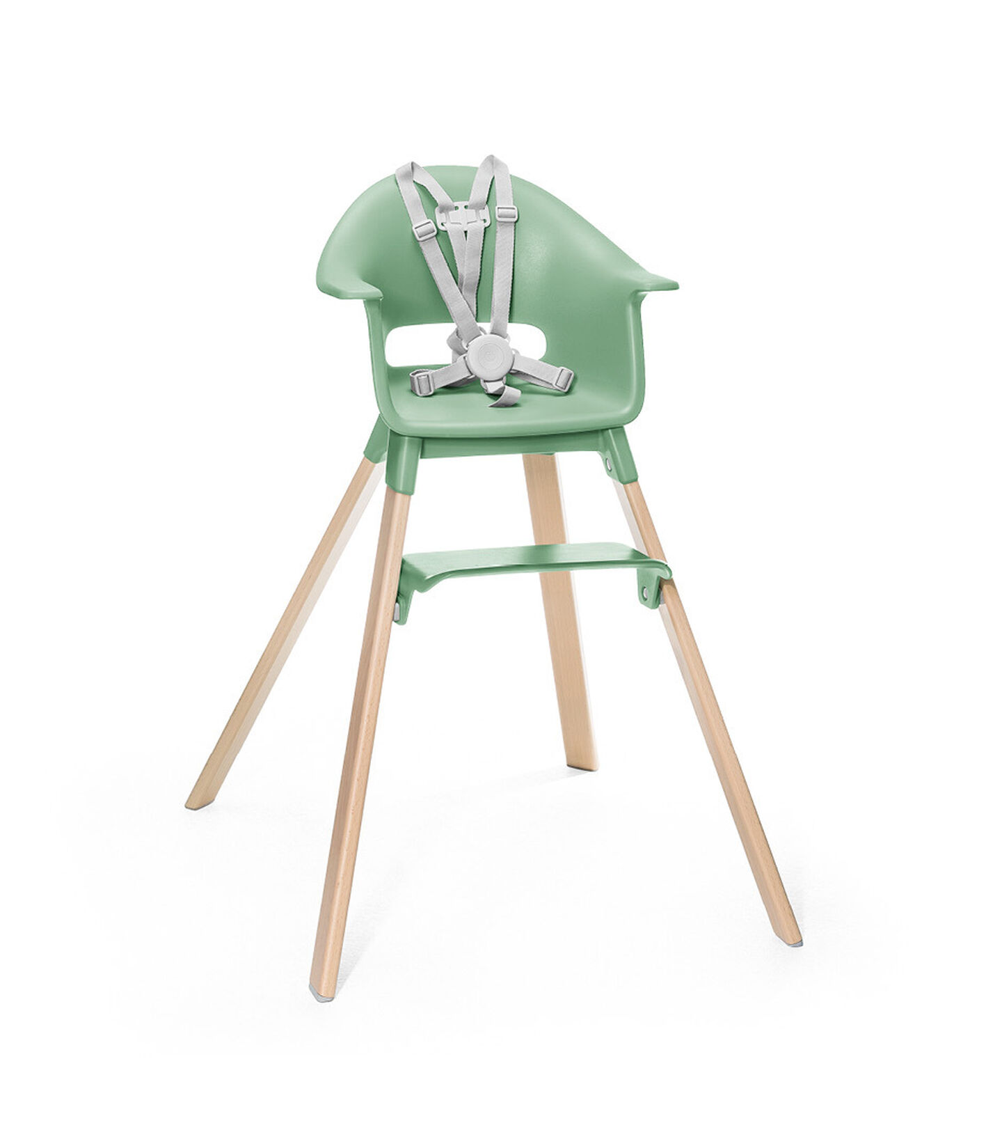 Stokke® Clikk™ High Chair. Natural Beech wood and Clover Green plastic parts. Stokke® Harness attached. Footrest low.