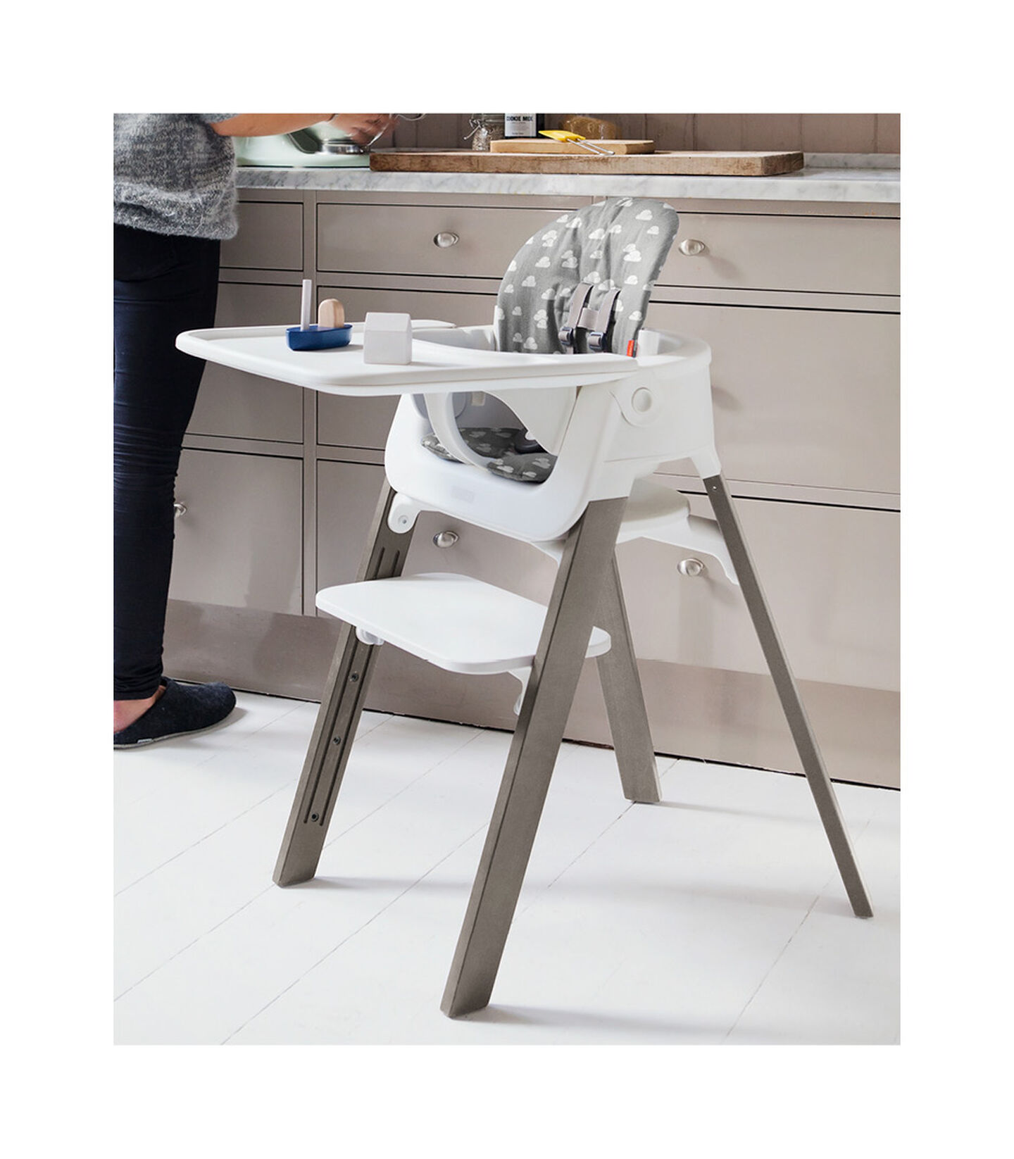 Stokke® Steps™ Hazy Grey with Baby Set and Tray. Grey Clouds Cushion. view 2