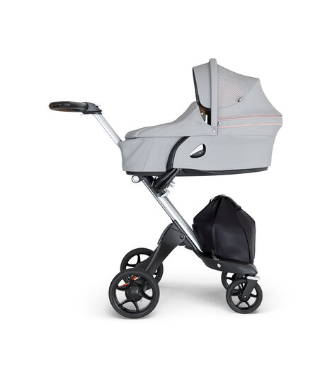 Stokke® Xplory® wtih Silver Chassis and Leatherette Brown handle. Stokke® Stroller Carry Cot Athleisure Pink. view 3