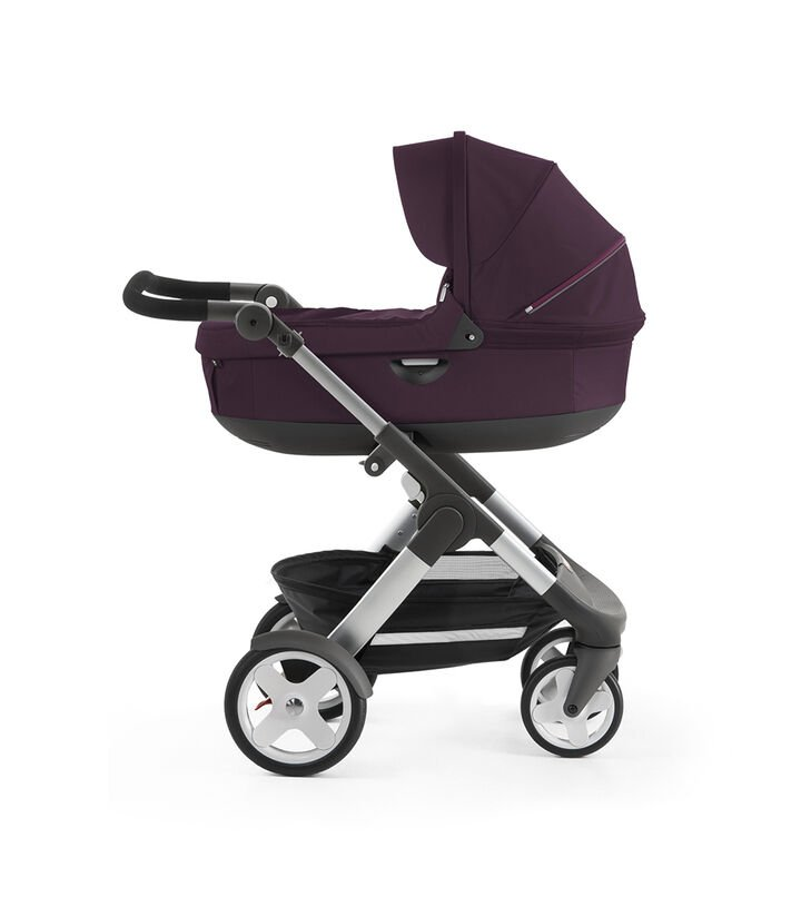 Stokke® Trailz™ with Stokke® Stroller Carry Cot, Purple. Classic Wheels. view 1